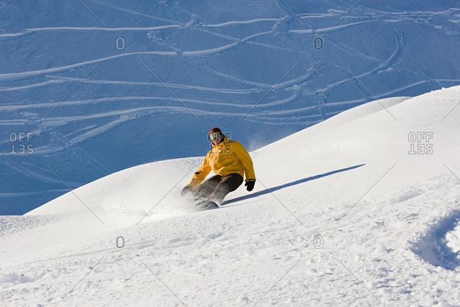 A man snowboarding