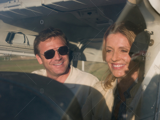 Couple in private airplane