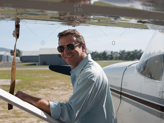 Man by private airplane