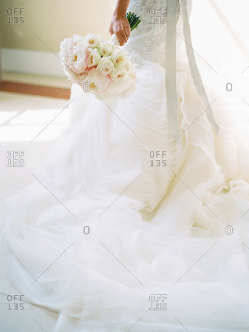 Low section of bride in gown