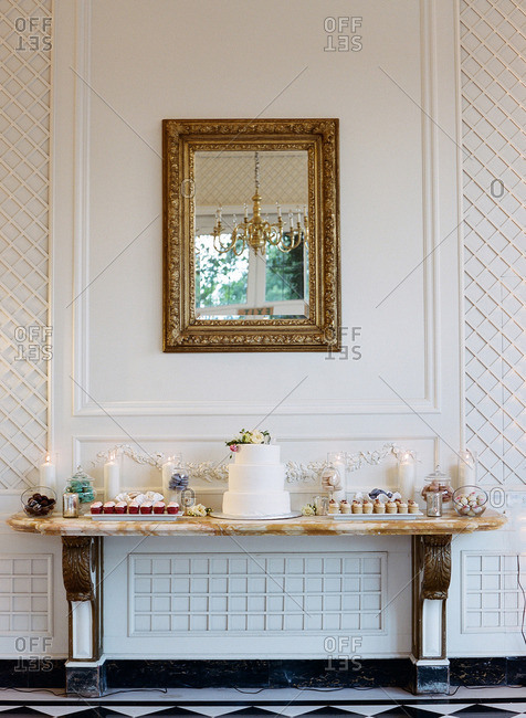 A wedding cake table against wall