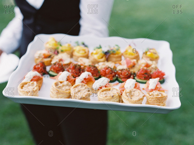 Serving variety of wedding appetizers