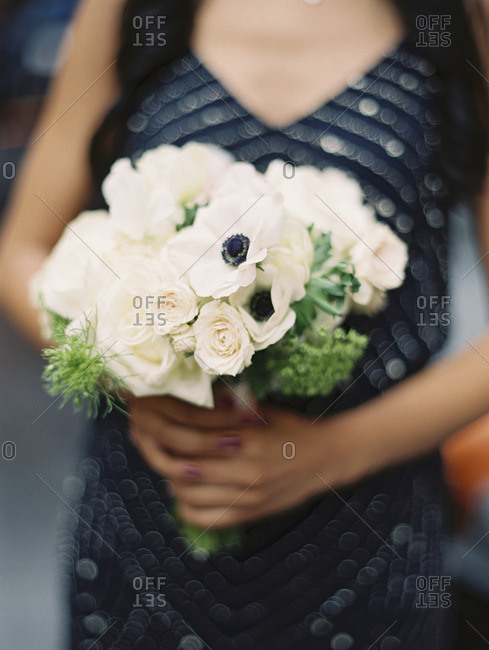 Woman with rose and poppy bouquet