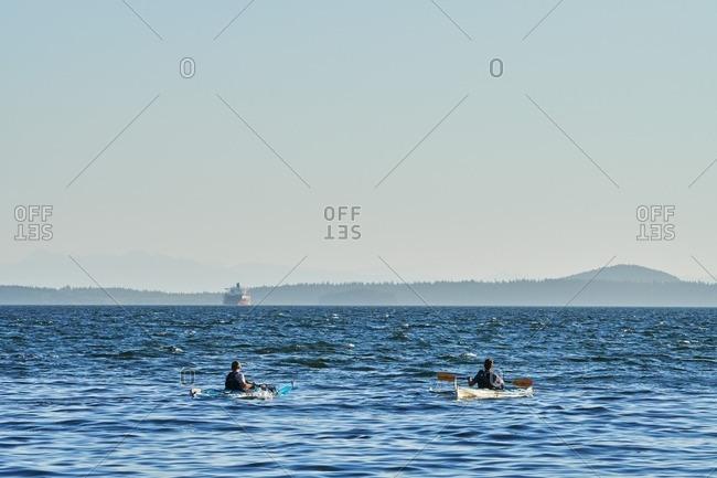 People kayaking in Pacific Northwest