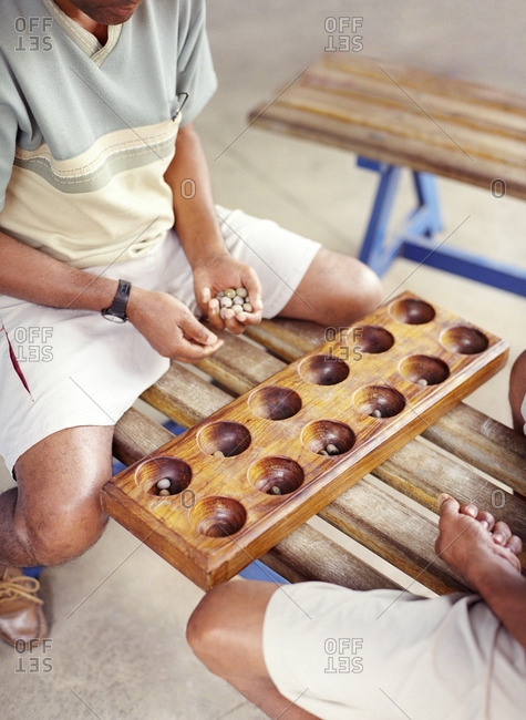 Two men playing the game of ouril in Mindelo, Cape Verde Islands