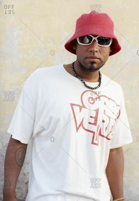 Cape Verde Island , Africa - November 2, 2010: Hip-hop dancer in a hat and sunglasses in Soa Felipe, Cape Verde Islands
