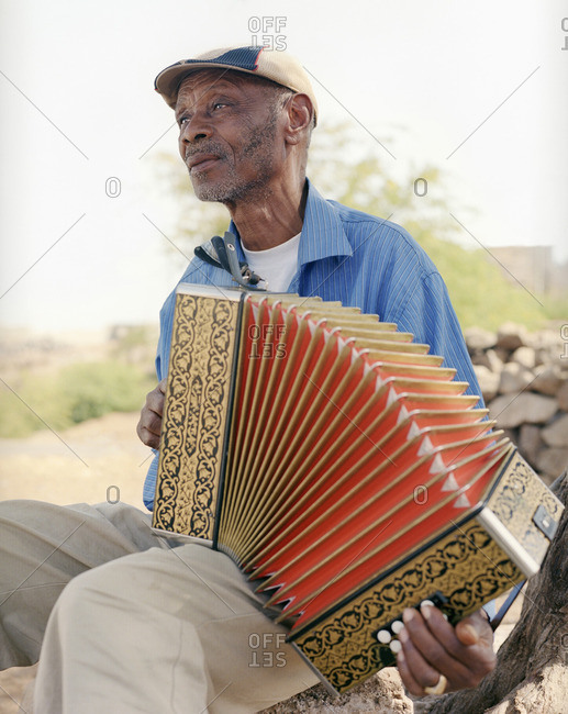 Cape Verde Island , Africa - November 3, 2010: Man playing traditional music on an accordion in the Cape Verde Islands
