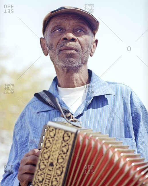 Cape Verde Island , Africa - November 4, 2010: Man playing an accordion in the Cape Verde Islands