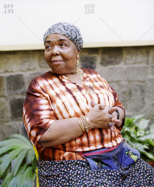 Cape Verde Island , Africa - January 22, 2008: Singer Cesaria Evora sitting in a chair outside her home in Sao Vincente, Cape Verde Islands