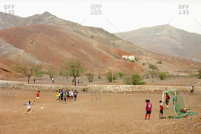 Cape Verde Island , Africa - November 2, 2010: Children playing soccer in a dirt field on Sao Vicente, Cape Verde Islands