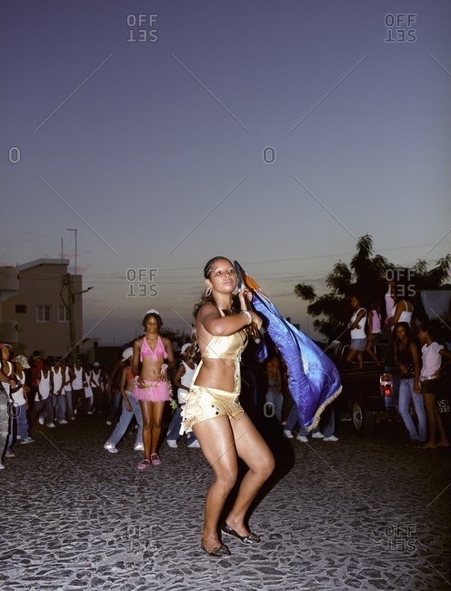 Cape Verde Island , Africa - December 9, 2010: Young woman waving a flag for a carnival on Fogo, Cape Verde Islands