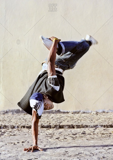 Cape Verde Island , Africa - December 9, 2010: Hip-hop dancer performing a one-arm handstand in Sao Felipe, Cape Verde Islands