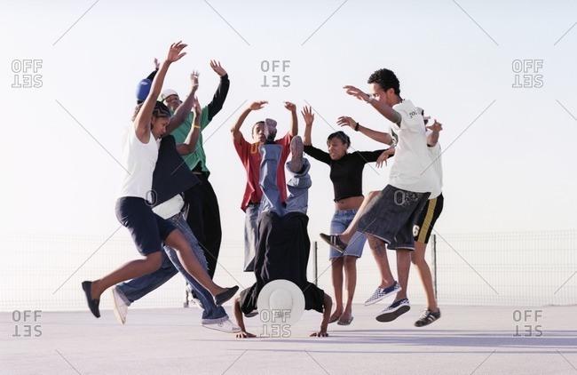 Cape Verde Island , Africa - December 9, 2010: Members of a hip-hop troupe dancing in a circle in Sao Felipe, Cape Verde Islands