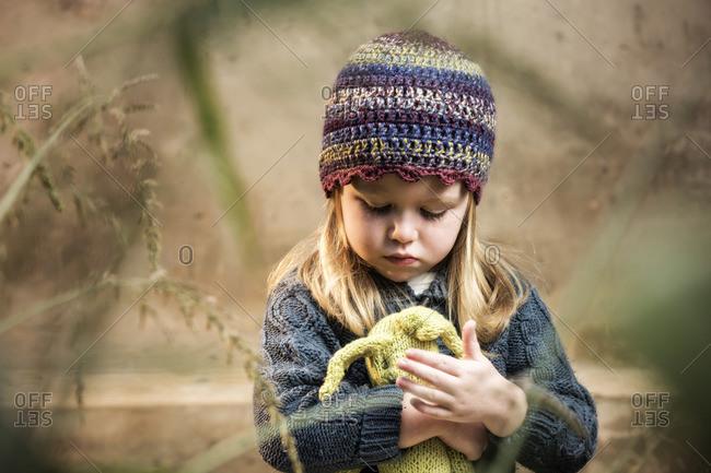 Portrait of a little girl holding a teddy bear
