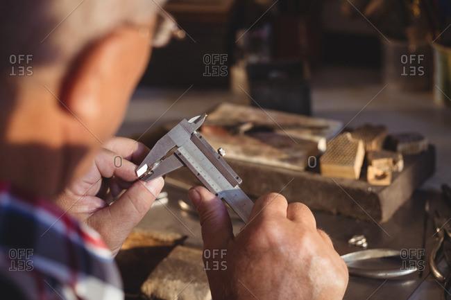 Ring maker measuring a ring