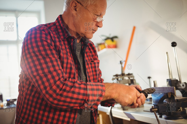 Man using pliers making jewelry