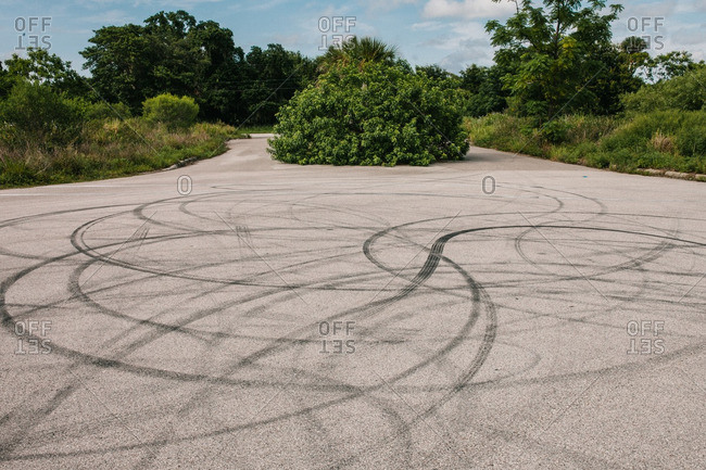 Curving tire marks on an empty parking lot