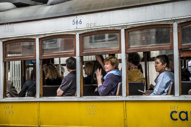 Lisbon, Portugal - April 14, 2014: Tram in Lisbon with tourists