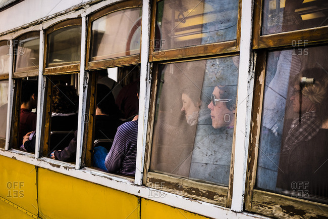 Lisbon, Portugal - April 15, 2014: Tram with tourist in the capital of Portugal