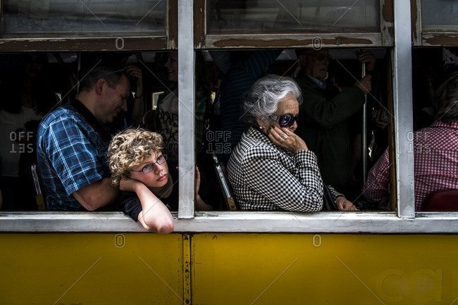 Lisbon, Portugal - April 15, 2014: Yellow tram with tourist in the capital of Portugal