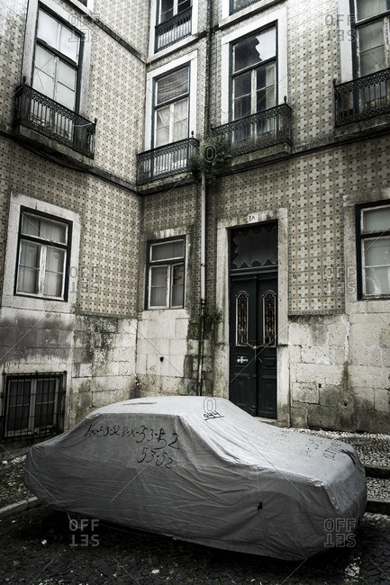 Lisbon, Portugal - April 16, 2014: Covered car and street in Alfama district in the capital of Portugal