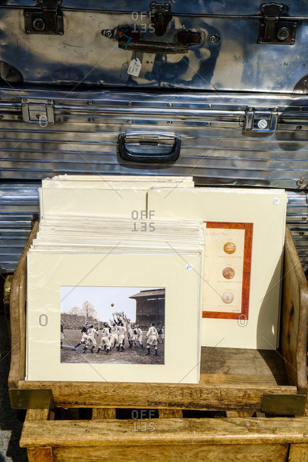London, England - July 30, 2014: Pictures and metal suitcases at a vintage market in Portobello Road in Notting Hill in London