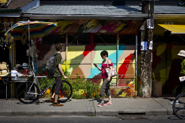 Toronto, Canada - June 24, 2013: Pedestrians in the Kensington area of Toronto, Canada