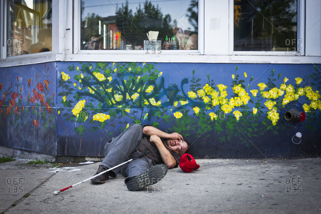 Toronto, Canada - June 24, 2013: A homeless man in the Chinatown area of Toronto, Canada