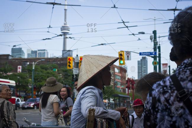 Toronto, Canada - June 24, 2013: A Vietnamese street vendor in the Chinatown area of Toronto, Canada