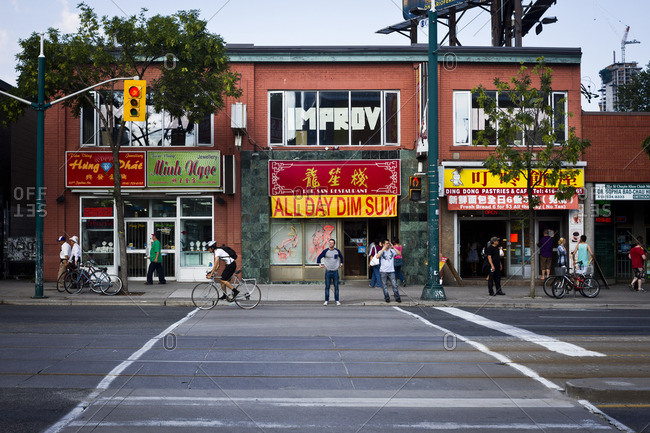 Toronto, Canada - June 24, 2013: Pedestrians in the Chinatown area of Toronto, Canada