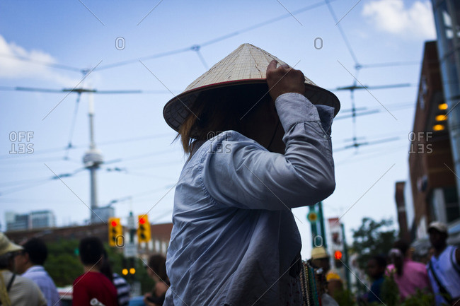 Toronto, Canada - June 24, 2013: Close up of a Vietnamese street vendor in the Chinatown area of Toronto, Canada
