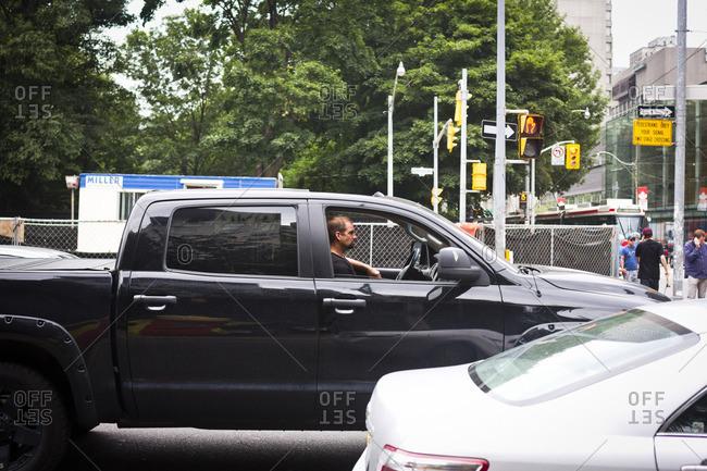 Toronto, Canada - June 26, 2013: A driver in traffic in Toronto, Canada