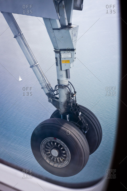 Toronto, Canada - June 96, 2013: Wheels of a plane preparing to land over Lake Ontario in Toronto, Canada
