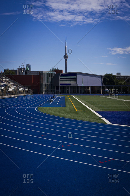Toronto, Canada - July 1, 2013: A view of the NC Tower from a blue sports track in Toronto, Canada
