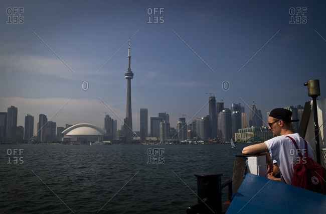 Toronto, Canada - July 4, 2013: A ferry passenger overlooking Lake Ontario in Toronto, Canada