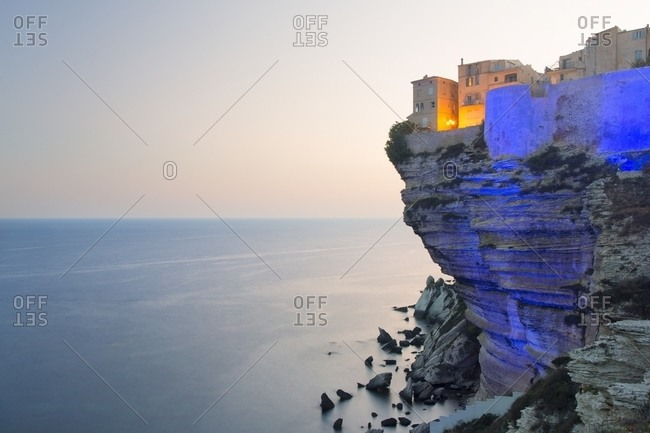 Projection of colored lights on the cliffs of Bonifacio, Corsica, France