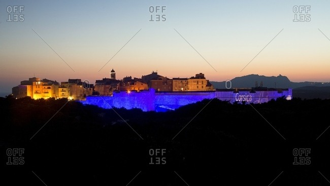 Corsica, France - July 1, 2016: Projection of colored lights on cliff