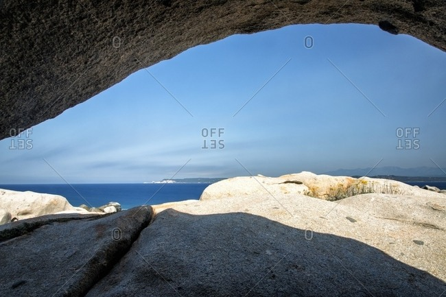 View through stone formations on the beach of the Lavezzi islands in Bonifacio, Corsica, France