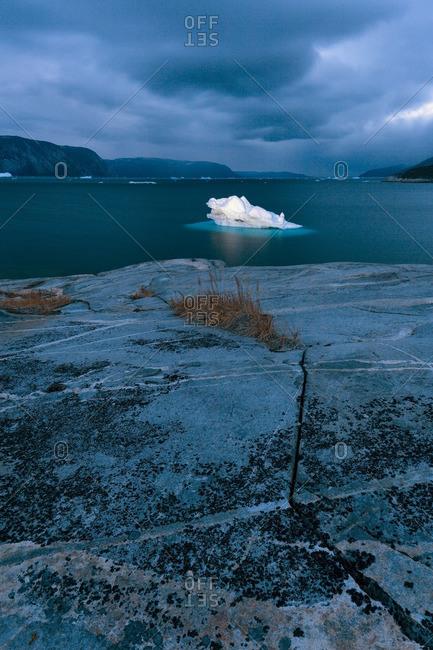 Dark clouds above an iceberg in Disko Bay, Greenland