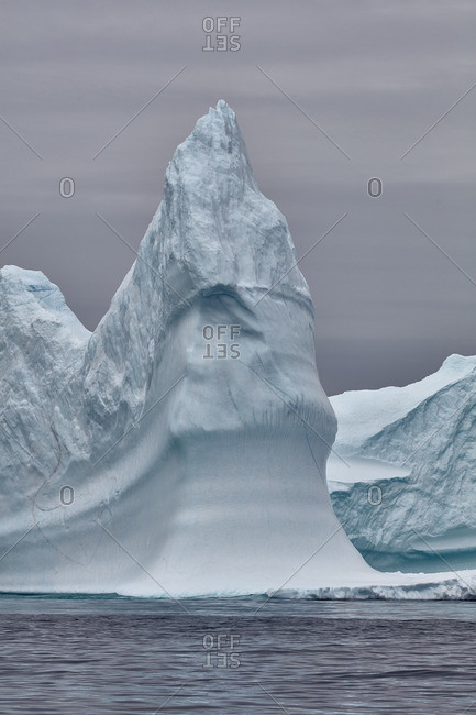 Pointed iceberg jutting into the sea