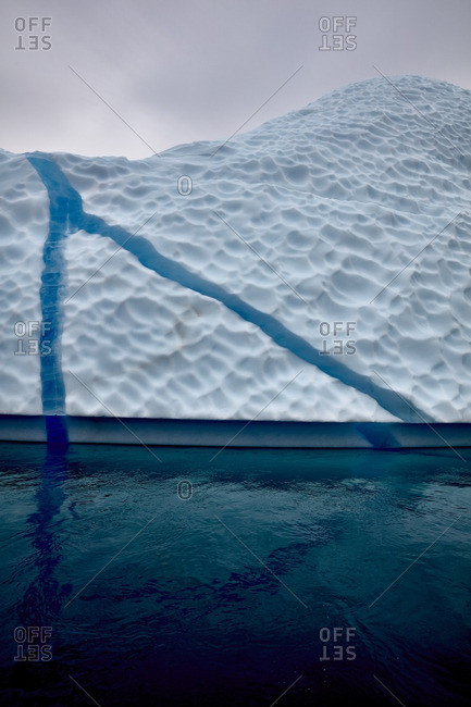 Blue veins in a large iceberg near the coast of Greenland
