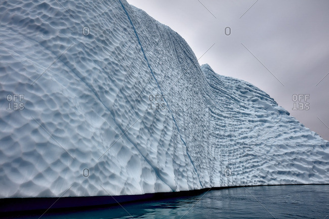 Ridges and veins in a massive iceberg near the coast of Greenland