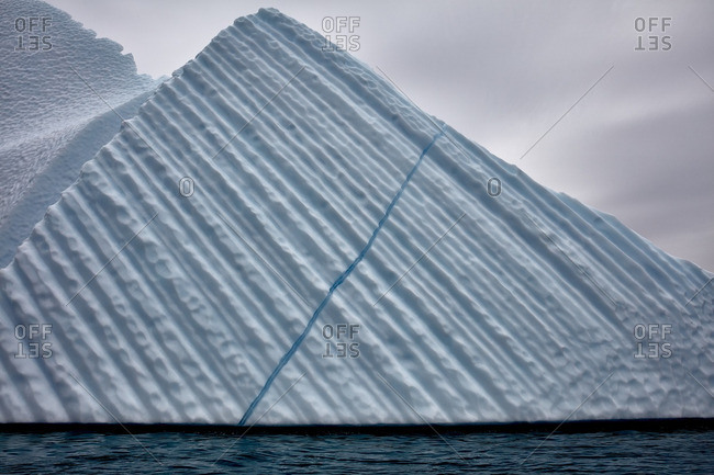 Blue vein running through the side of a large iceberg in Greenland