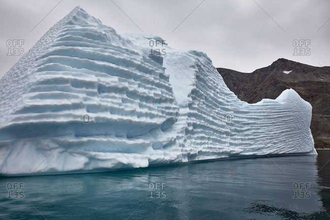 Ice formation with deep ridges near coastal mountains in Greenland