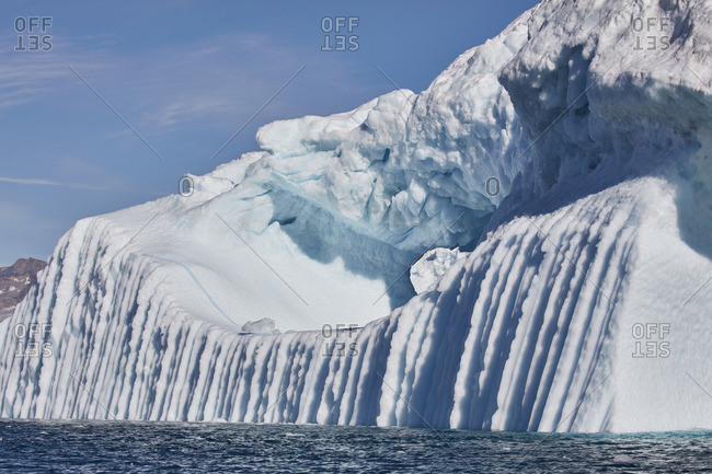 Ice cliff with deep ridges on the coast of Greenland