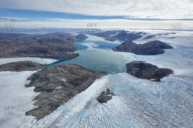 Aerial view of mountains and the Heim Glacier in Greenland