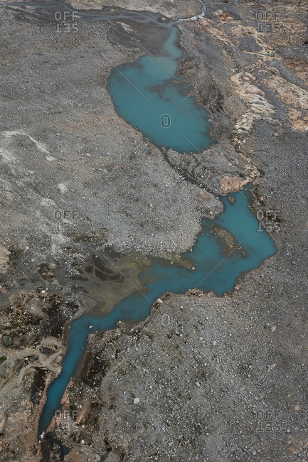 Blue lake on a rocky landscape in Greenland