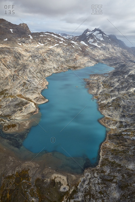 Blue lake among a mountainous landscape in Greenland