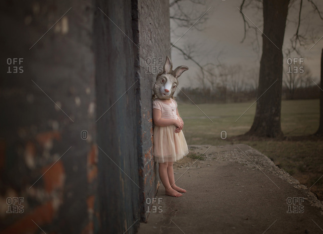 Girl wearing a rabbit mask