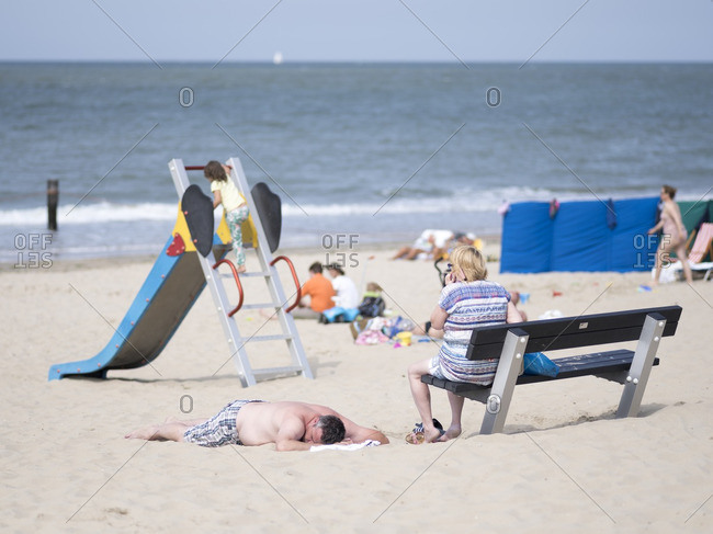 Netherlands - August 18, 2016: People relaxing and playing on a sandy beach in the Netherlands